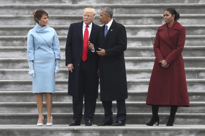 President Trump and former President Barack Obama stand on the steps of the U.S. Capitol with first lady Melania Trump and former first lady Michelle Obama, Jan. 20, 2017. (Photo by Rob Carr/Getty Images)