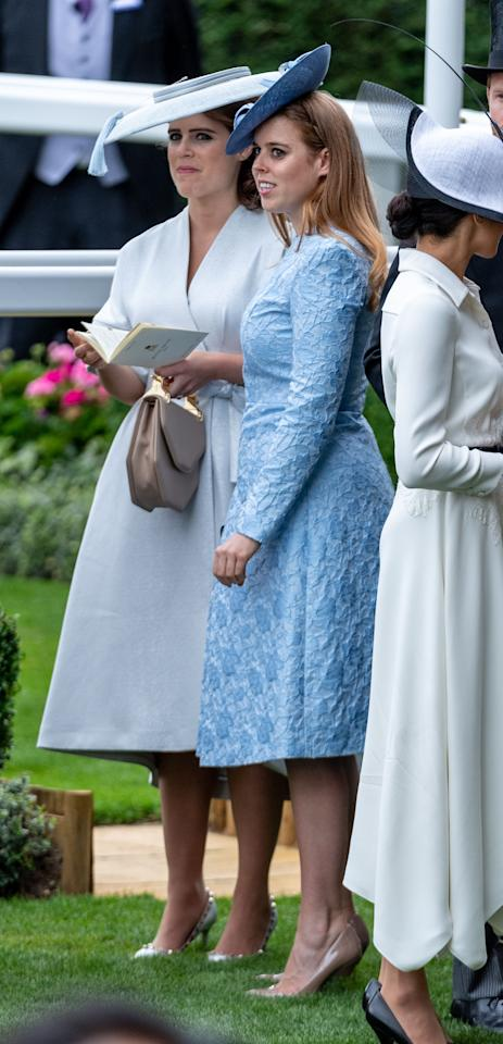 <p>Soon-to-be wed Eugenie was dressed in a white kimono dress by Osman which she paired with a matching wide-brimmed Jules Millinery hat, Valentino shoes and a bag by M2Malletier. Photo: Getty </p>