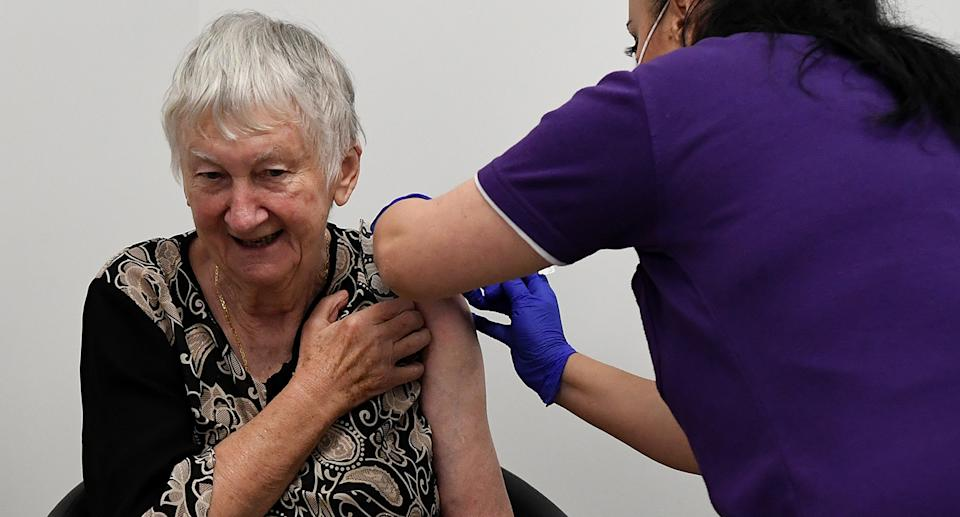 Aged care resident Jane Malysiak receives the first Codid-19 vaccine in Australia during a visit to Castle Hill Medical Centre to preview the COVID-19 vaccination program on Sunday, February 21, 2021. (AAP Image/Joel Carrett) NO ARCHIVING
