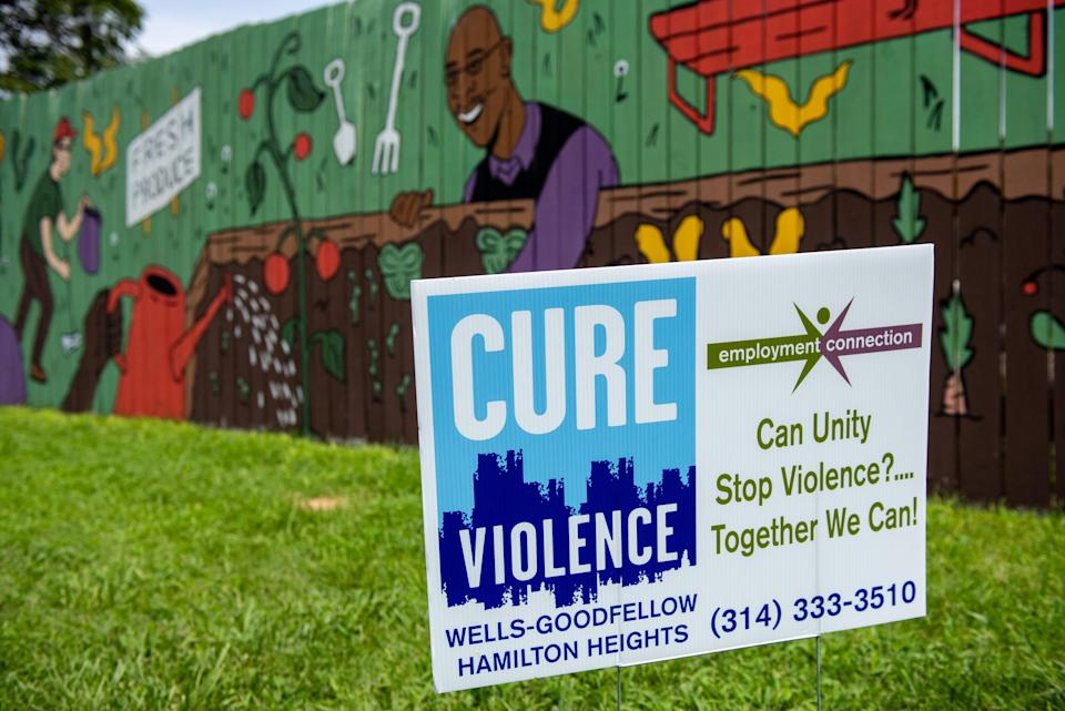 The St. Louis Story Stitchers artistic collective tries to mend the emotional wounds of gun violence through expression and art. Its projects include murals in the Wells-Goodfellow neighborhood.