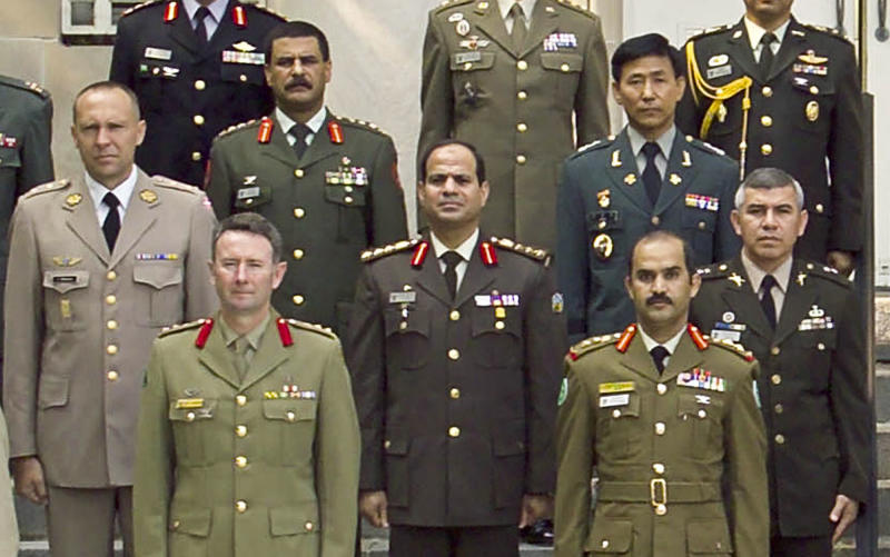 ALTERNATE CROP - This undated 2006 photograph provided by the U.S. Army War College photo lab shows Egyptian Brig. Gen. Abdel-Fattah el-Sissi, center, in a group photo of the International Fellows class of 2006 in Carlisle, Pennsylvania. The head of Egypt's military, Abdel-Fattah el-Sissi, is riding on a wave of popular fervor that is almost certain to carry him to election as president. Unknown only two years ago, a broad sector of Egyptians now hail him as the nation's savior after he ousted the Islamists from power, and the state-backed personality cult around him is so eclipsing, it may be difficult to find a candidate to oppose him if he runs. Still, if he becomes president, he faces the tough job of ruling a deeply divided nation that has already turned against two leaders. (AP Photo/U.S. Army War College photo lab)
