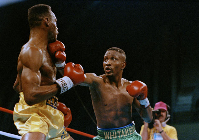 "Pernell ""Sweetpea"" Whitaker, right, throws a punch at the chin of Freddie Pendleton in the second round of their IBF/WBC Lightweight Boxing Championship in Atlantic City, N.J., Feb. 4, 1990. Whitaker retains his title with a 12-round decision. (AP Photo/Bruce Boyajian)"