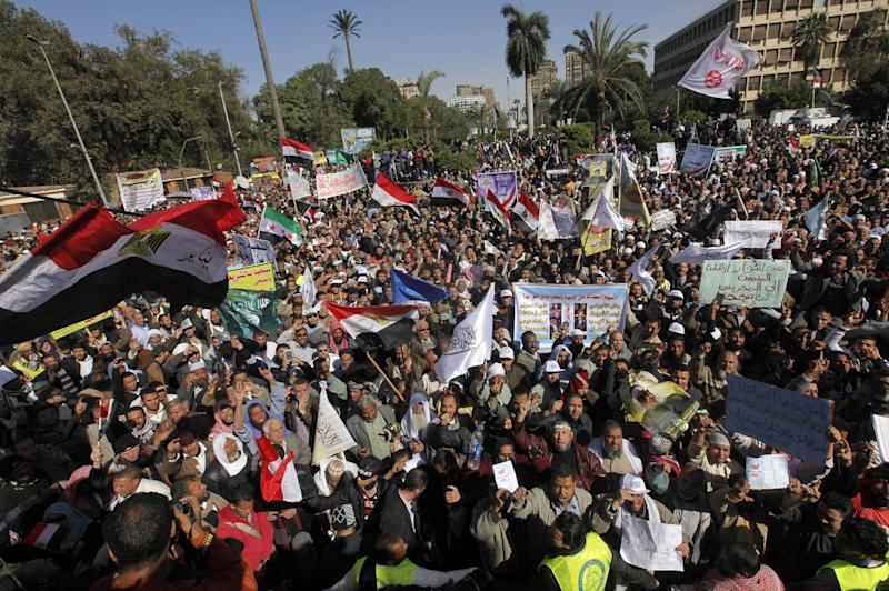 Thousands of Egyptian protesters shout slogans supporting Islamist President Mohammed Morsi during a rally outside Cairo University in Cairo, Egypt, Friday, Feb. 15, 2013. Around 5,000 mostly hardline Islamists are rallying in Egypt against a recent wave of protests that has killed around 70 people. (AP Photo/Amr Nabil)
