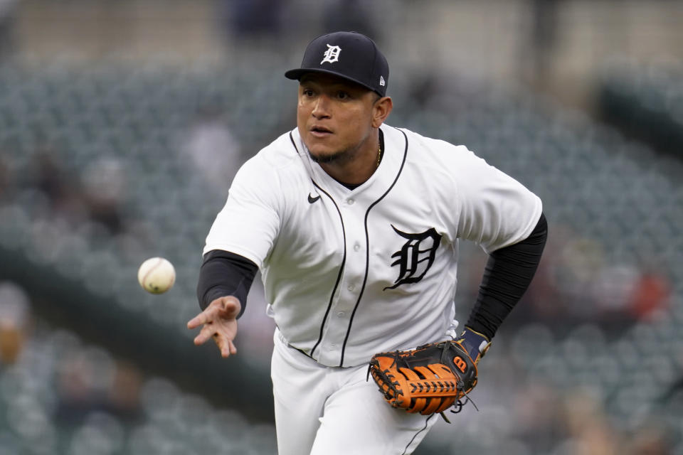 Detroit Tigers first baseman Miguel Cabrera tosses the ball to first base for an out against the Minnesota Twins in the third inning of a baseball game in Detroit, Friday, May 7, 2021. (AP Photo/Paul Sancya)