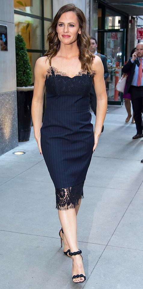 """<p>Garner stepped out in N.Y.C. on Thursday looking polished as can be in a navy pinstriped Victoria Beckham dress with tasteful lace trim ($2,680; <a rel=""""nofollow"""" href=""""http://www.saksfifthavenue.com/main/ProductDetail.jsp?PRODUCT%3C%3Eprd_id=845524447057595&"""">saksfifthavenue.com</a>) and studded AlaÏa sandals ($1,430; <a rel=""""nofollow"""" href=""""https://www.net-a-porter.com/ca/en/product/756500/alaia/studded-suede-sandals"""">net-a-porter.com</a>). </p>"""