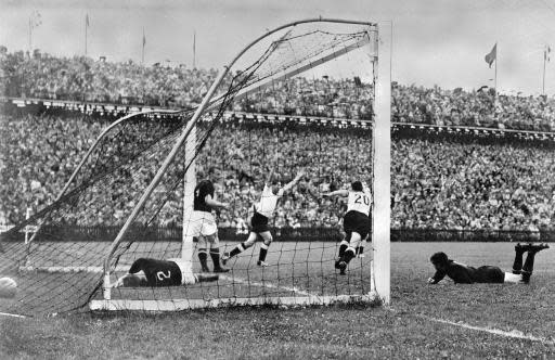FILE - In this July 4, 1954 file photo, West Germany's Helmut Rahn, center with arms raised, celebrates after equalizing in the World Cup soccer final match against Hungary, at Wankdorf Stadium, in Bern, Switzerland. West Germany would go on to win the match 3-2. Once again, Germany dug deep Saturday, June 23, 2018 to eke out a victory to keep its World Cup hopes alive. It's something German teams have made a habit of at World Cups. (AP Photo/File)