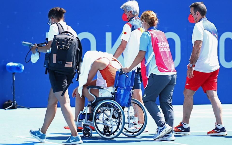 Paula Badosa leaves the court in a wheelchair - REUTERS