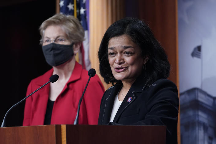 FILE - In this March 1, 2021, file photo Rep. Pramila Jayapal, D-Wash., right, with Sen. Elizabeth Warren, D-Mass., at left, speaks during a news conference on Capitol Hill in Washington. One side is energized by the prospect of the greatest expansion of government support since the New Deal nearly a century ago. The other is fearful about dramatically expanding Washington's reach at an enormous cost. They are all Democrats, yet are taking vastly different approaches to the the massive $3.5 trillion spending bill moving through Congress. (AP Photo/Susan Walsh, File)