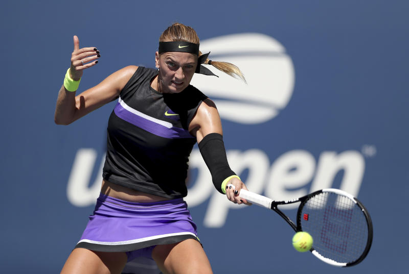 Petra Kvitova, of the Czech Republic, returns a shot to Andrea Petkovic, of Germany, during the second round of the US Open tennis championships Thursday, Aug. 29, 2019, in New York. (AP Photo/Eduardo Munoz Alvarez)