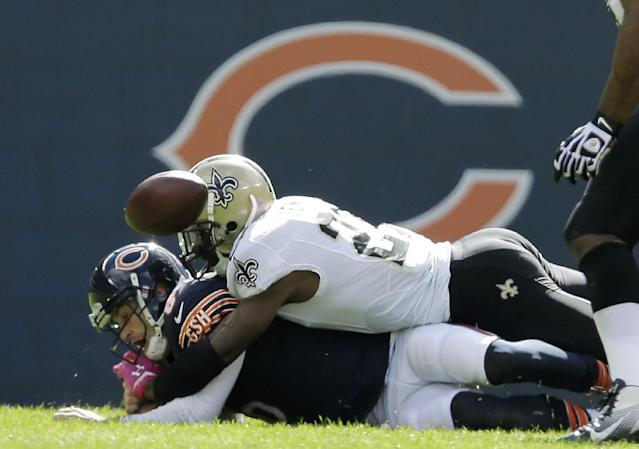 Chicago Bears quarterback Jay Cutler (6) fumbles the ball as New Orleans Saints free safety Malcolm Jenkins (27) tackles him during the first half of an NFL football game, Sunday, Oct. 6, 2013, in Chicago.(AP Photo/Nam Y. Huh)