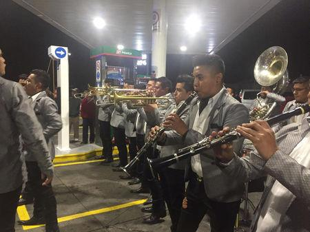 People play Sinaloan band music at a gas station in Morelia, Michoacan, Mexico January 9, 2019 in this picture obtained via social media. Charles Cuin/via REUTERS