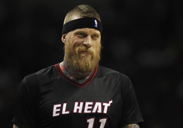 Miami Heat forward Chris Andersen smiles at a fan during the second half of an NBA basketball game against the San Antonio Spurs on Thursday, March 6, 2014, in San Antonio. San Antonio won 111-87. (AP Photo/Darren Abate)