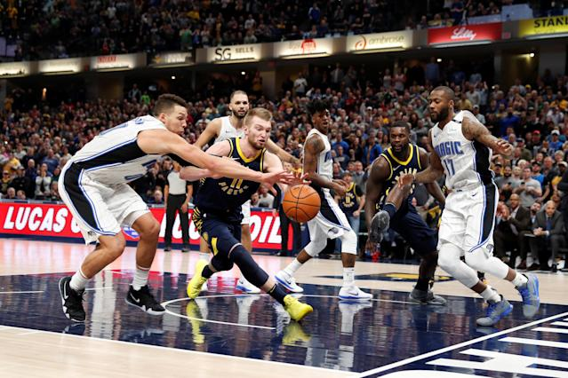 Jan 27, 2018; Indianapolis, IN, USA; Indiana Pacers forward Domantas Sabonis (11) and a Orlando Magic forward Aaron Gordon (00) chase after a loose ball during the 4th quarter at Bankers Life Fieldhouse. Mandatory Credit: Brian Spurlock-USA TODAY Sports TPX IMAGES OF THE DAY