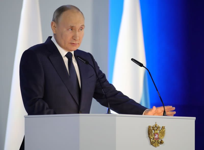 FILE PHOTO: Russian President Putin delivers his annual address to the Federal Assembly in Moscow