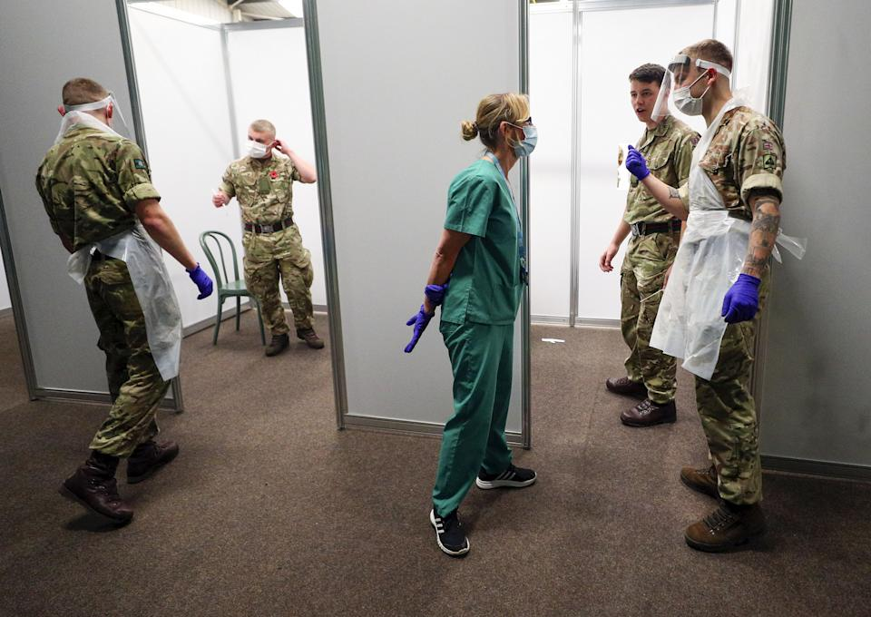 Soldiers practice on themselves at the Liverpool Tennis Centre in Wavertree, before the start of the mass Covid-19 testing in Liverpool. (Photo by Peter Byrne/PA Images via Getty Images)