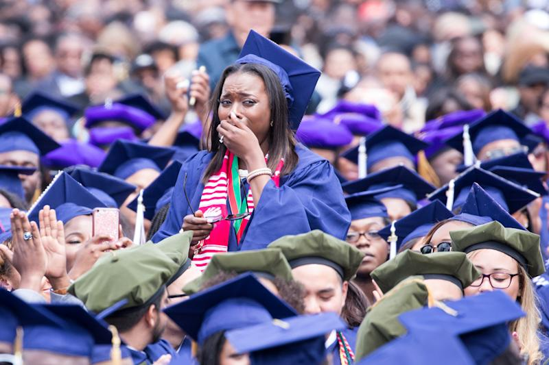 Washington, D.C. On Saturday, May 7 at Howard University Upper Quandrangle University Campus, Howard University School of Communications graduate (Public Relations major) Cierra Jefferson stands and cries, as Commencement speaker President Barack Obama tells her story of struggle and triumph, at the 148th Commencement Convocation. (Photo by Cheriss May/NurPhoto via Getty Images)