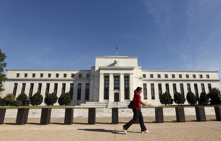Woman walks past the Federal Reserve in Washington