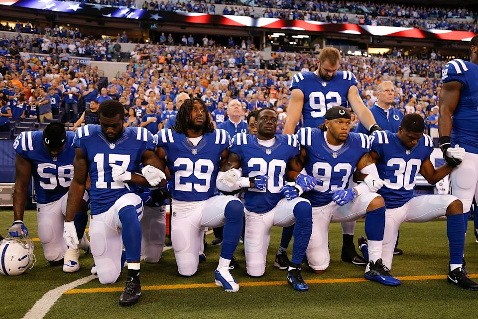 Members of the Indianapolis Colts stand and kneel for the national anthem prior to the start of the game between the Indianapolis Colts and the Cleveland Browns at Lucas Oil Stadium on September 24, 2017 in Indianapolis, Indiana. (Photo by Michael Reaves/Getty Images)