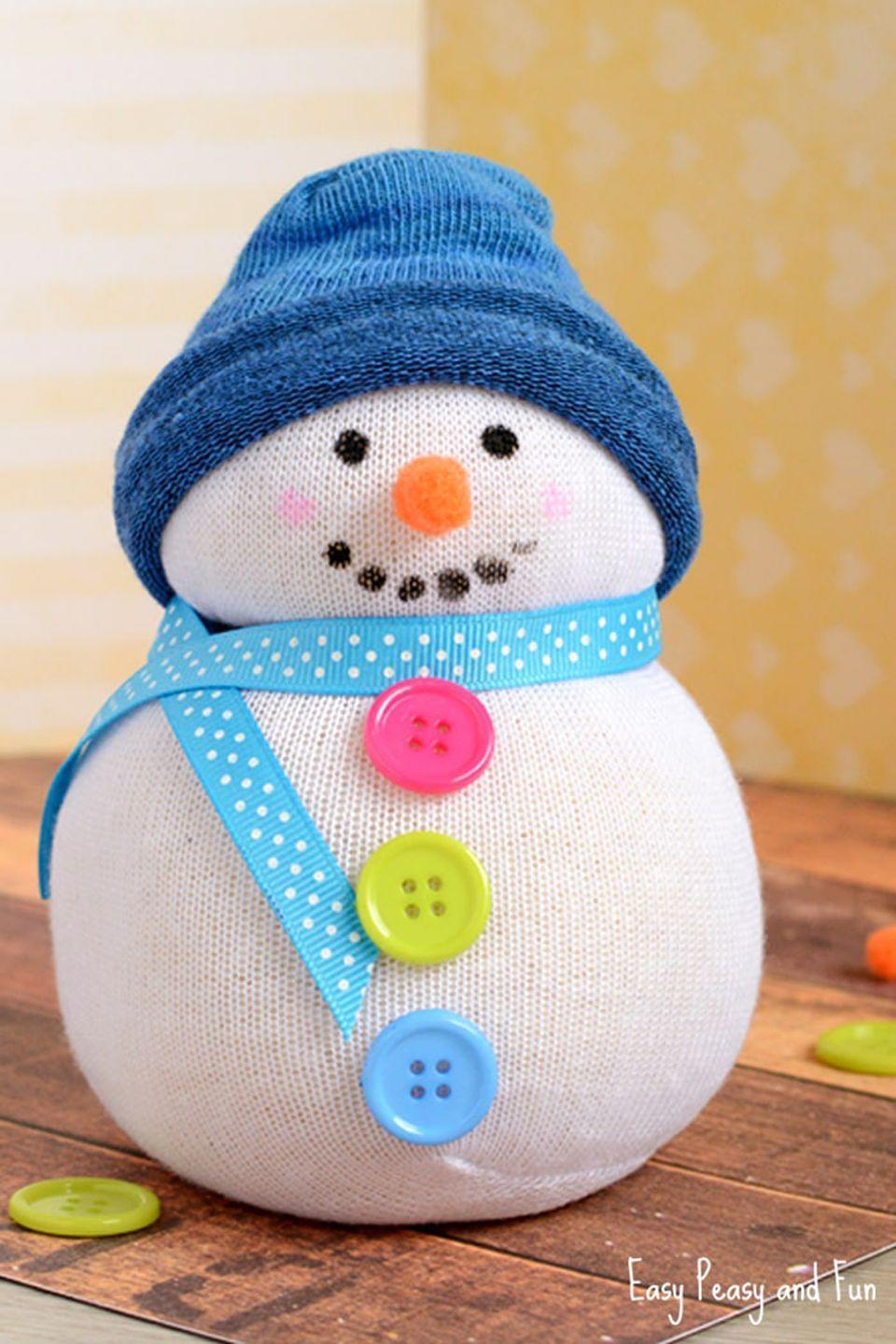 "<p>Forget the needle and thread—grab some socks and buttons instead! </p><p><strong>Get the tutorial at <a href=""https://www.easypeasyandfun.com/no-sew-sock-snowman-craft/"" rel=""nofollow noopener"" target=""_blank"" data-ylk=""slk:Easy Peasy and Fun"" class=""link rapid-noclick-resp"">Easy Peasy and Fun</a>.</strong></p>"
