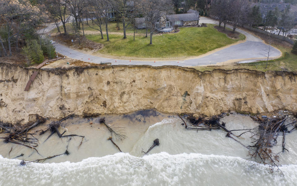 FILE - In this Dec. 4, 2019 file photo, widespread Lake Michigan shoreline erosion reaches Dune Lane and approaches homes in Stevensville, Mich. A months-long spell of dry, mild weather is giving the Great Lakes a break after two years of high water that shattered records and heavily damaged shoreline roads and homes, officials said Monday May 10, 2021. (Robert Franklin/South Bend Tribune via AP. File)