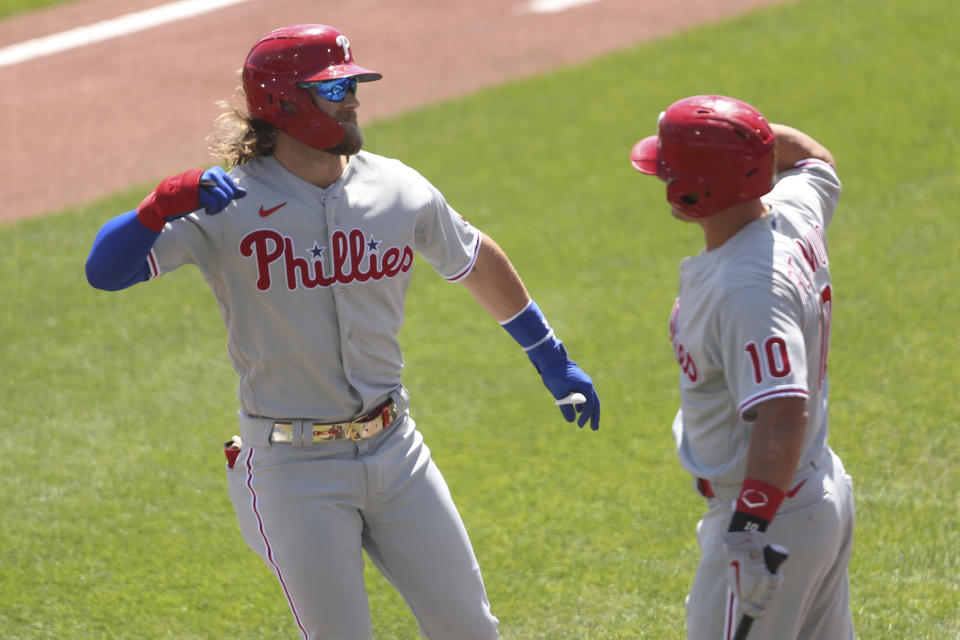Philadelphia Phillies' Bryce Harper, left, celebrates his home run with teammate J.T. Realmuto during the first inning of the first game of a baseball doubleheader against the Toronto Blue Jays, Thursday, Aug. 20, 2020, in Buffalo, N.Y. (AP Photo/Jeffrey T. Barnes)