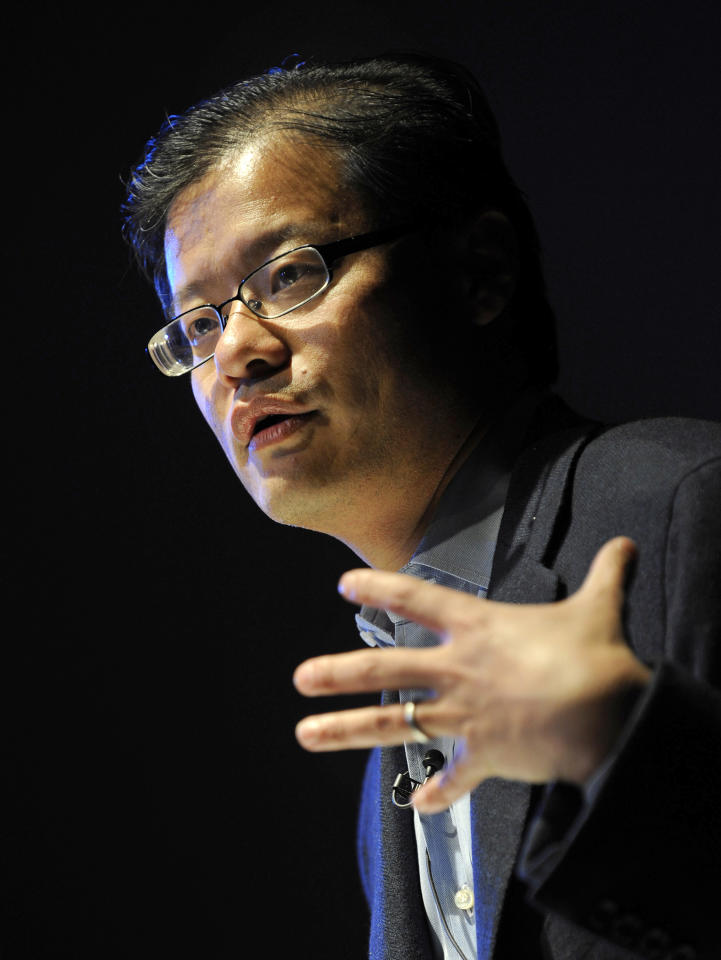 Yang, CEO and co-founder of Yahoo!, gestures as he addresses a conference in central London.