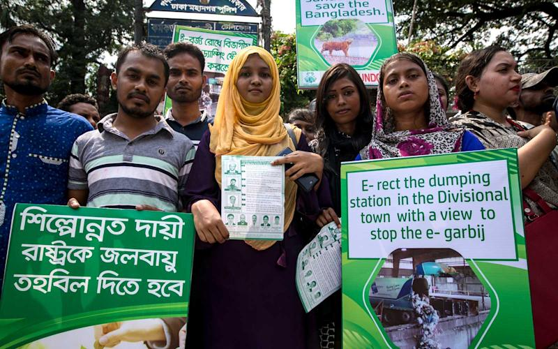 Students and protesters gather to attend a climate strike rally in Dhaka, Bangladesh on September 20, 2019. Bangladeshi people joined together in front of the Press Club as part of a global mass demand action on climate change. | Barcroft Media/Getty Images