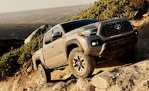 "<p>Marty McFly dreamt of owning one. And it's clear to see why. The <a href=""https://www.caranddriver.com/toyota/tacoma"" rel=""nofollow noopener"" target=""_blank"" data-ylk=""slk:Toyota Tacoma"" class=""link rapid-noclick-resp"">Toyota Tacoma</a> TRD Pro features a four-wheel-drive system with an electronically controlled dual-range transfer case and an electronic locking rear differential. The suspension is lifted with TRD-specific springs and 2.5-inch Fox internal-bypass dampers. For 2020, the aggressive, blocky exterior gets a distinctive grille, and the whole thing rides on 16-inch wheels inside Kevlar-reinforced Goodyear Wrangler all-terrain tires. Plus, a slick camera system helps the driver spot obstacles.<br></p>"
