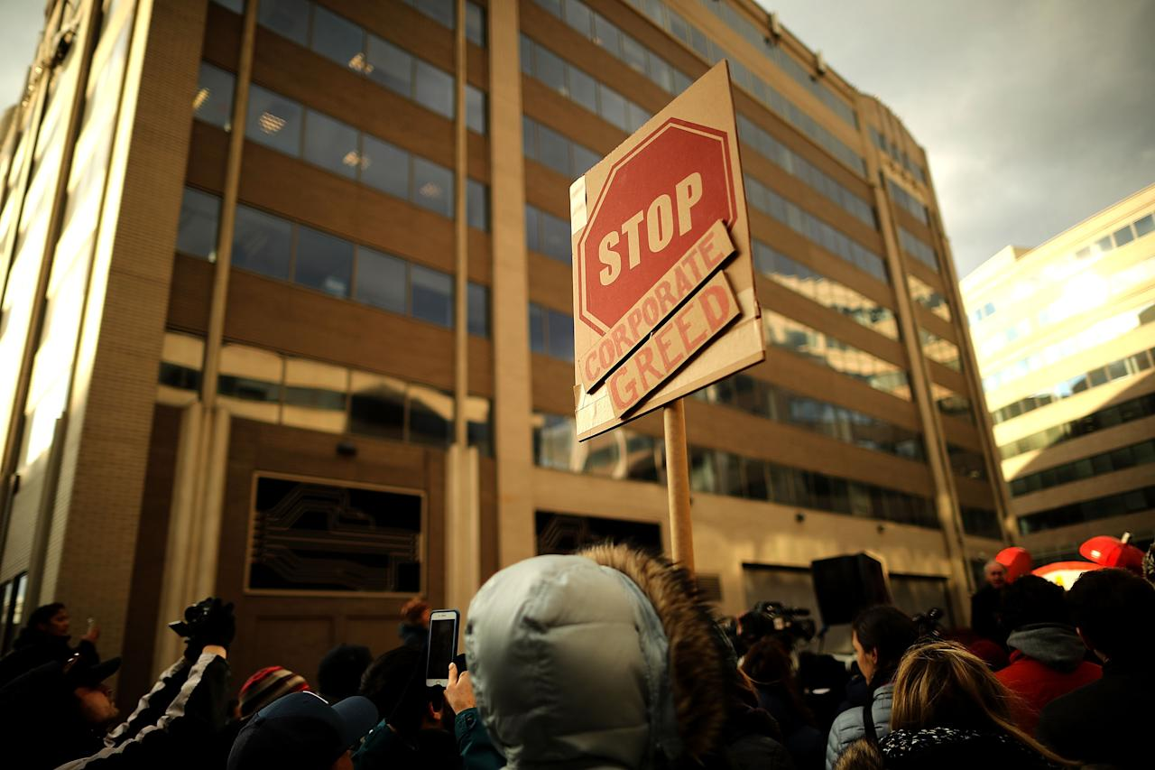 <p>Demonstrators rally outside the Federal Communication Commission building to protest against the end of net neutrality rules, Dec. 14, 2017 in Washington. (Photo: Chip Somodevilla/Getty Images) </p>