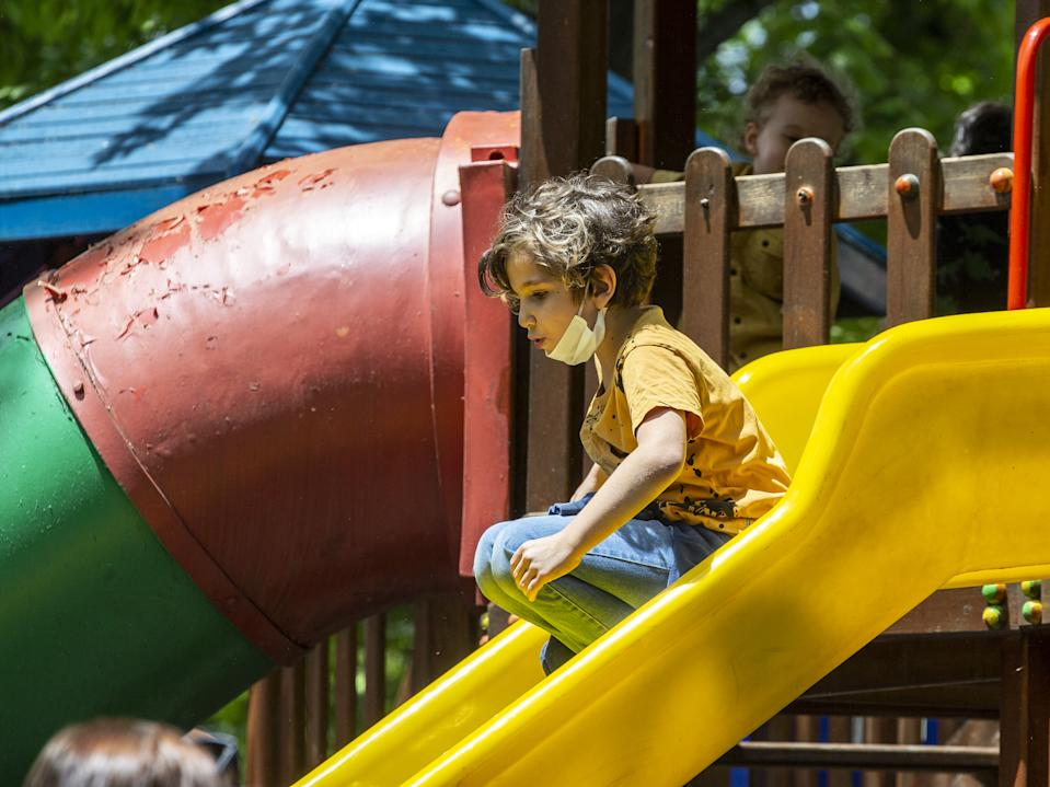 ANKARA, TURKEY - MAY 27: A child slides at Kugulu Park after children under 14 years across Turkey allowed to leave their homes, remaining within walking distance and wearing masks within measures taken against coronavirus (Covid-19) pandemic in Ankara, Turkey on May 27, 2020. (Photo by Ali Balikci/Anadolu Agency via Getty Images)