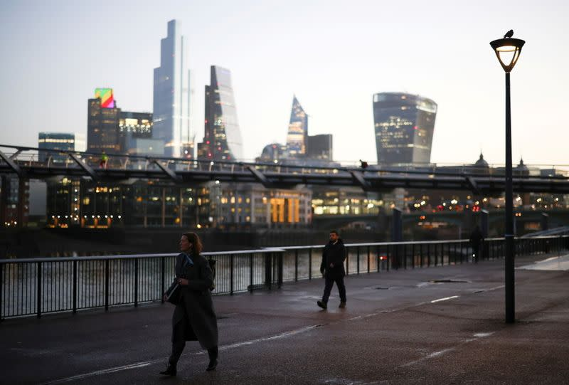 The financial district can be seen as a people walk along the South bank, amid the coronavirus disease (COVID-19) outbreak, in London