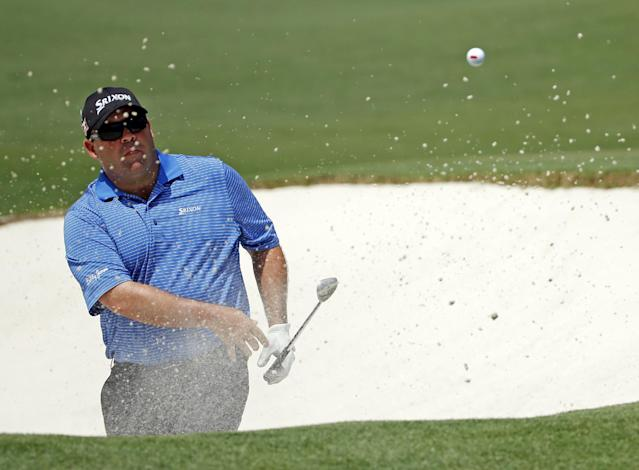 Kevin Stadler hits out of a bunker on the second fairway during the fourth round of the Masters golf tournament Sunday, April 13, 2014, in Augusta, Ga. (AP Photo/Matt Slocum)