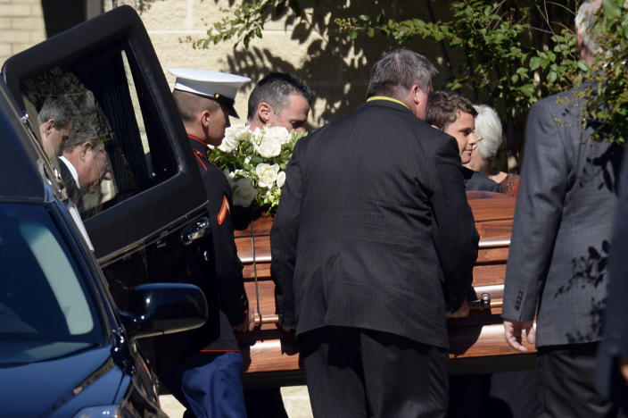 The casket for Navy Yard shooting victim John R. Johnson arrives at Good Shepherd Lutheran Church in Gaithersburg, Md., Tuesday, Sept. 24, 2013, for Johnson's funeral service. (AP Photo/Susan Walsh)