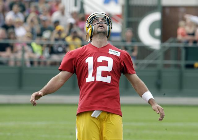 Green Bay Packers' Aaron Rodgers looks up during a drill during NFL football training camp Saturday, July 26, 2014, in Green Bay, Wis. (AP Photo/Morry Gash)