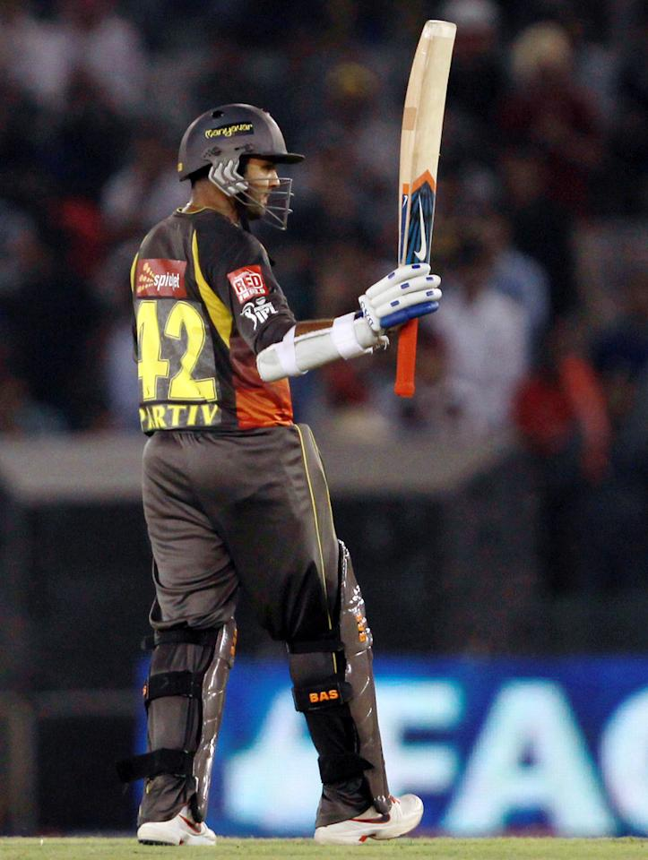 Parthiv Patel raises his bat in celebration of his half century during match 59 of of the Pepsi Indian Premier League between The Kings XI Punjab and the Sunrisers Hyderabad held at the PCA Stadium, Mohali, India  on the 11th May 2013. (BCCI)