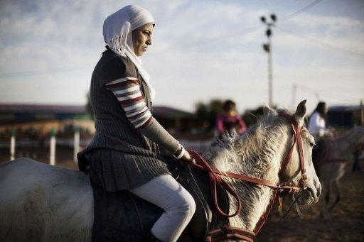 Ola Abu Safia, 18, rides a horse at the Al-Faisal riding centre in Gaza City on January 10, 2012. Horse riding has become a popular hobby in the Gaza Strip but local Palestinians face constant hurdles -- from a conservative society to Israel's blockade on the territory -- to practise the sport on their home turf