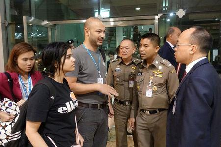 Saudi teen Rahaf Mohammed al-Qunun is seen with Thai immigration authorities at a hotel inside Suvarnabhumi Airport in Bangkok