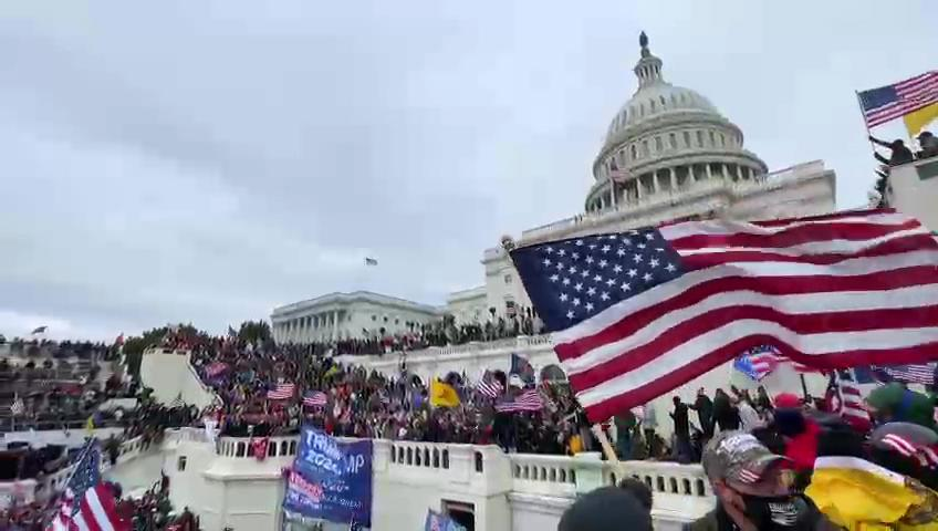 WASHINGTON D.C., USA - JANUARY 6: A screen grab captured from a video shows US President Donald Trumps supporters gather outside the Capitol building in Washington D.C., United States on January 06, 2021. Pro-Trump rioters stormed the US Capitol as lawmakers were set to sign off Wednesday on President-elect Joe Biden's electoral victory in what was supposed to be a routine process headed to Inauguration Day. (Photo by Lokman Vural Elibol/Anadolu Agency via Getty Images)