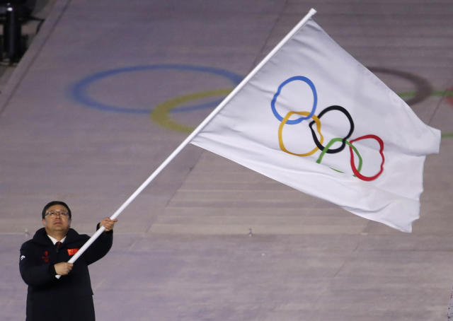 Chen Jining mayor of Beijing waves the Olympic flag during the closing ceremony of the 2018 Winter Olympics in Pyeongchang, South Korea, Sunday, Feb. 25, 2018. (AP Photo/Natacha Pisarenko)