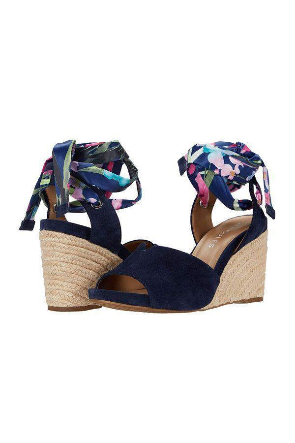 """<p><strong>Aerosoles</strong></p><p>zappos.com</p><p><strong>$79.05</strong></p><p><a href=""""https://go.redirectingat.com?id=74968X1596630&url=https%3A%2F%2Fwww.zappos.com%2Fp%2Faerosoles-cleverdale-navy-combo%2Fproduct%2F9389662&sref=https%3A%2F%2Fwww.oprahdaily.com%2Fstyle%2Fg36055944%2Fmost-comfortable-wedges%2F"""" rel=""""nofollow noopener"""" target=""""_blank"""" data-ylk=""""slk:SHOP NOW"""" class=""""link rapid-noclick-resp"""">SHOP NOW</a></p><p>Floral ankle ties lend these dressy espadrilles a dash of whimsy but don't worry, they still have the memory foam insole that makes Aerosoles so comfortable. </p>"""