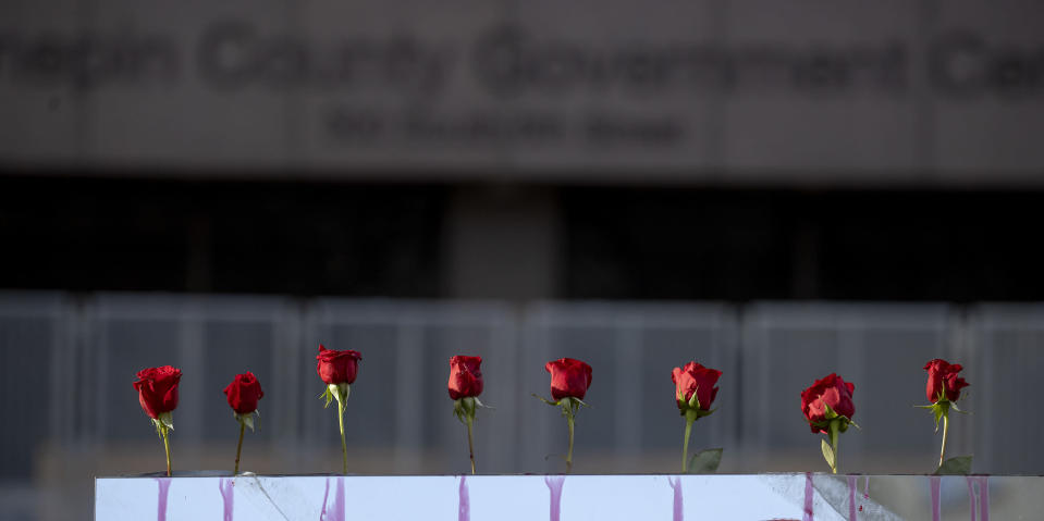 Roses are set up outside of the Hennepin County Government Center on the first day of the Derek Chauvin trial, Monday, March 8, 2021 in Minneapolis, Minn. Chauvin is the former Minneapolis police officer charged in the death of George Floyd. (Elizabeth Flores/Star Tribune via AP)