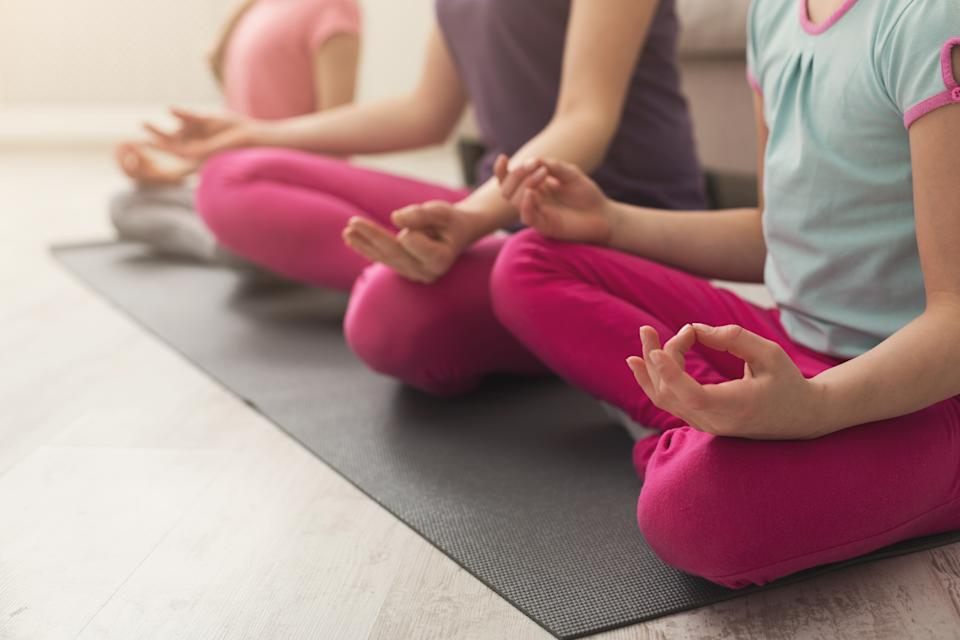 Pupils at the Bel-Air pod begin the day with yoga stretches and meditation. (Photo: Getty Creative stock photo)