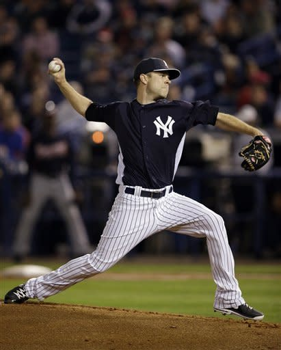 New York Yankees' David Phelps pitches during the first inning of a spring training exhibition baseball game against the Atlanta Braves, Tuesday, March 5, 2013, in Tampa, Fla. (AP Photo/Matt Slocum)