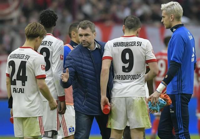 Bernd Hollerbach with Hamburg players at the end of Saturday's 6-0 drubbing at the hands of Bayern Munich