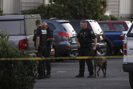 Investigators searched an apartment Thursday evening where the suspected gunman lived with his mother about two miles from Umpqua Community College. (Steve Dipaola/Reuters)