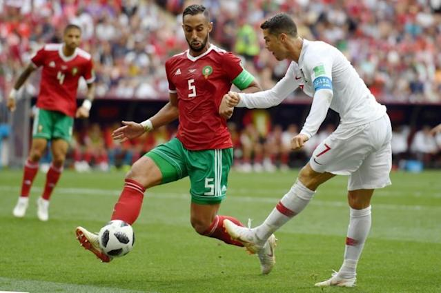 Morocco's Mehdi Benatia (L) fights for the ball with Portugal's Cristiano Ronaldo during their Russia 2018 World Cup Group B match, at the Luzhniki Stadium in Moscow, on June 20