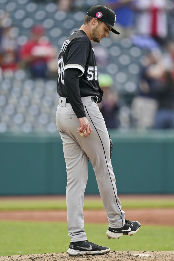 Chicago White Sox starting pitcher Jimmy Lambert kicks the mound after giving up a two-run home run to Cleveland Indians' Jose Ramirez in the third inning of the second baseball game of a doubleheader, Monday, May 31, 2021, in Cleveland. (AP Photo/Tony Dejak)