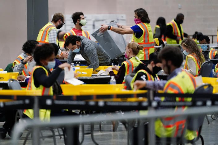 Philadelphia election workers process mail-in and absentee ballots for the 2020 general election in the United States at the Pennsylvania Convention Center, Tuesday, Nov. 3, 2020, in Philadelphia. (Matt Slocum/AP)
