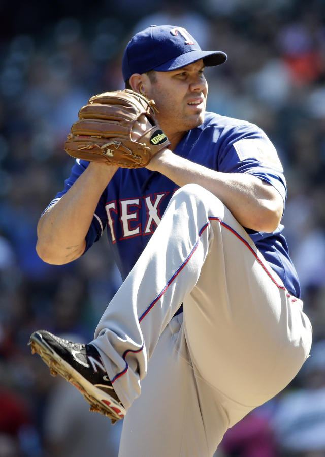 Texas Rangers starting pitcher Colby Lewis throws against the Seattle Mariners in the first inning of a baseball game Wednesday, Aug. 27, 2014, in Seattle. AP Photo/Elaine Thompson)