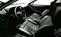 <p>While the 4.9-liter 12-cylinder, connected to the classic chromed gated shifter, gave it suitably supercar performance, the wild styling—particularly compared to the fairly tame 512BB predecessor—reflected the new, freewheeling Greed Decade. Those side strakes accentuated the impossibly wide rear fenders, which combined with the outstretched side mirror and the too-cool center-lock wheels to earn the Testarossa a place on countless teenage boys' bedroom walls, where its image seared into their brains. The Testarossa was the subject of exotic-car lust back then, and it's still a worthy lust object today. <em>—Joe Lorio</em></p>